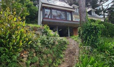 Façade mer de l'extension et son balcon